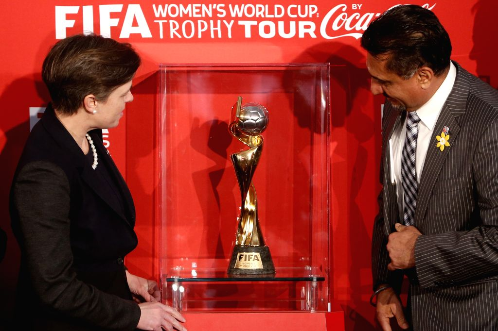 Minister of Labour and Minister for the Status of Women Dr. Kellie Leitch (L) and Minister of Sport Bal Gosal unveil the FIFA Women's World Cup Trophy in Ottawa, ...