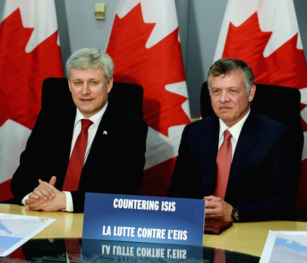 Canadian Prime Minister Stephen Harper (L) and visiting King Abdullah II of Jordan attend a press confernece after their meeting in Ottawa, Canada, April 29, 2015. ... - Stephen Harper