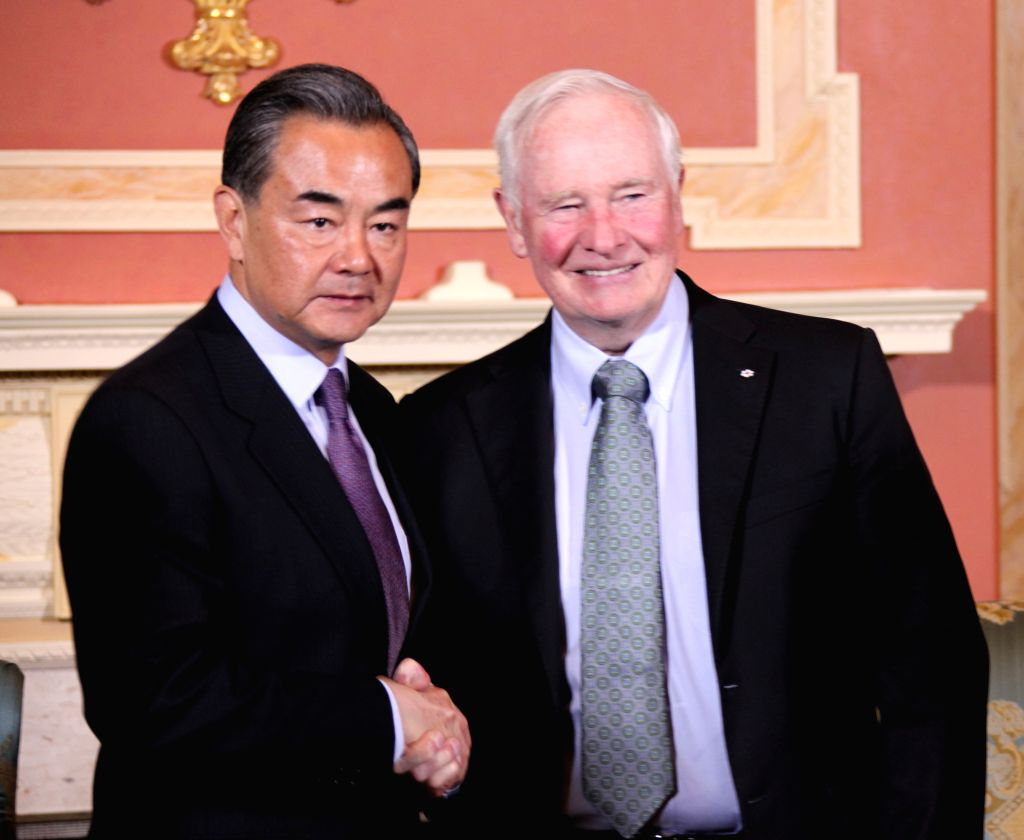 OTTAWA, June 2, 2016 - Canadian Governor General David Johnston (R) meets with visiting Chinese Foreign Minister Wang Yi in Ottawa, capital of Canada, on June 2, 2016. - Wang Y