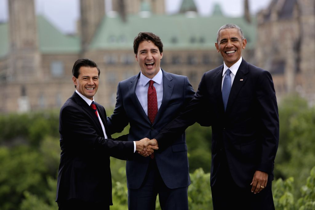 OTTAWA, June 30, 2016 - Mexican President Enrique Pena Nieto (L), Canadian Prime Minister Justin Trudeau (C) and U.S. President Barack Obama pose for group photos in front of Parliament Hill during ... - Justin Trudeau