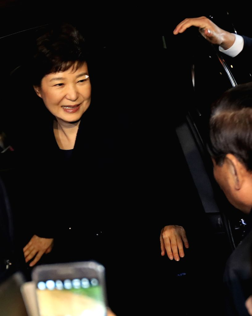 Ousted President Park Geun-hye gets out of a car in front of her private residence in southern Seoul after returning from the presidential office Cheong Wa Dae on March 12, 2017, two days ...