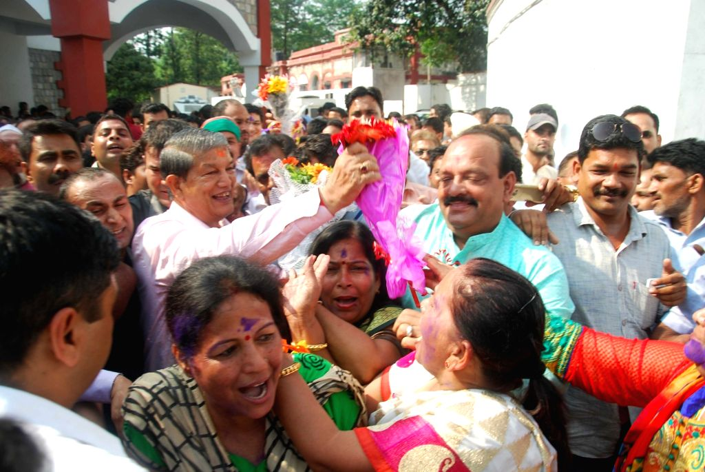 Ousted Uttarakhand Chief Minister Harish Rawat being greeted by people in dehradun after the central government told the Supreme Court that Rawat had the legislative majority and his ... - Harish Rawat