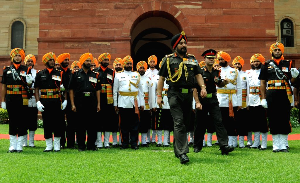 Outgoing Army Chief General Bikram Singh inspects Guard of Honour at South Block in New Delhi on July 31, 2014.