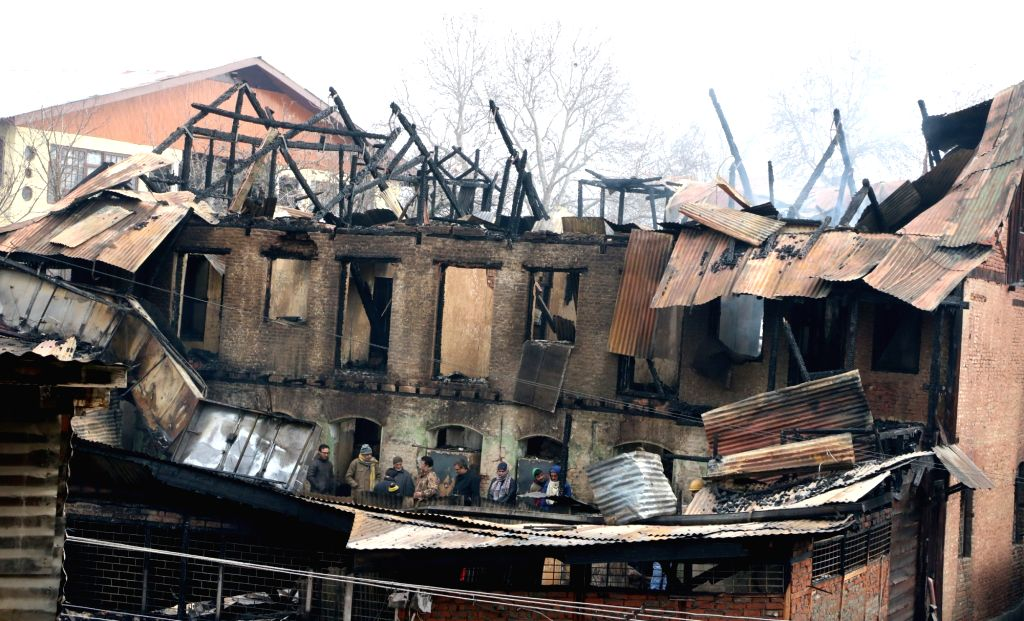 Over a dozen shops, two banks and a post office were gutted in a massive fire that broke out near Lal Chowk of Srinagar on Jan 13, 2017.