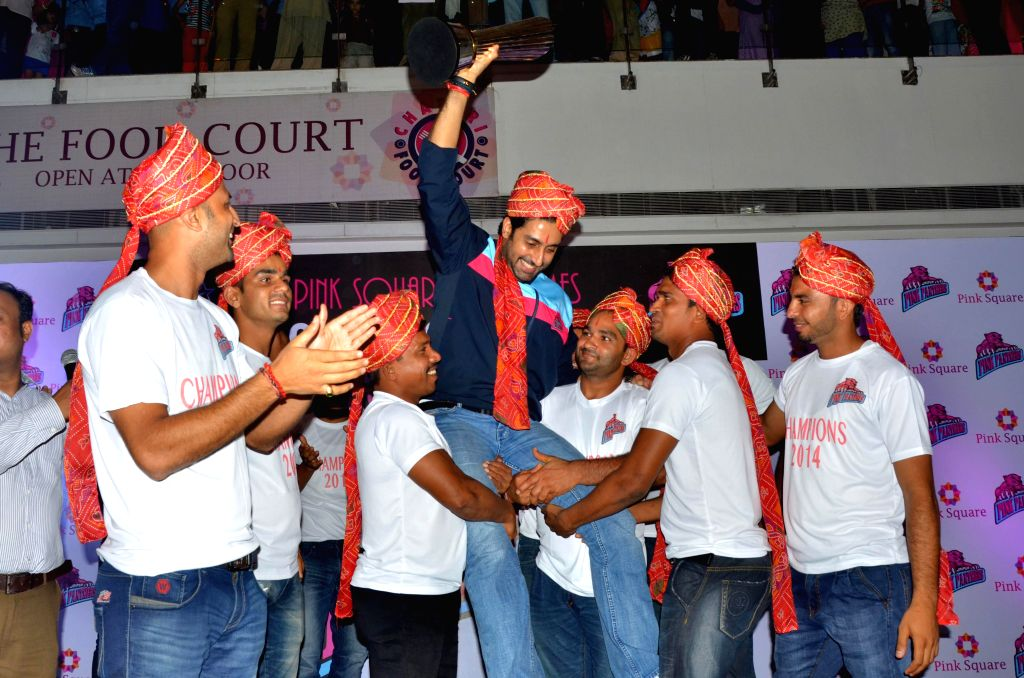 Owner of Jaipur Pink Panthers, actor Abhishek Bachchan being lifted by players of the team as they celebrate their victory in Pro Kabaddi League at Pink Square Mall in Jaipur on Sept 7, 2014. - Abhishek Bachchan
