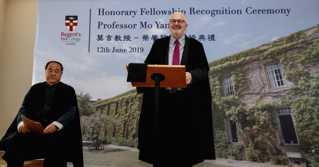 OXFORD (BRITAIN), June 12, 2019 Regent's Park College principal Robert Ellis (R) speaks during the Honorary Fellowship Recognition Ceremony of Chinese writer and Nobel laureate Mo Yan at ...