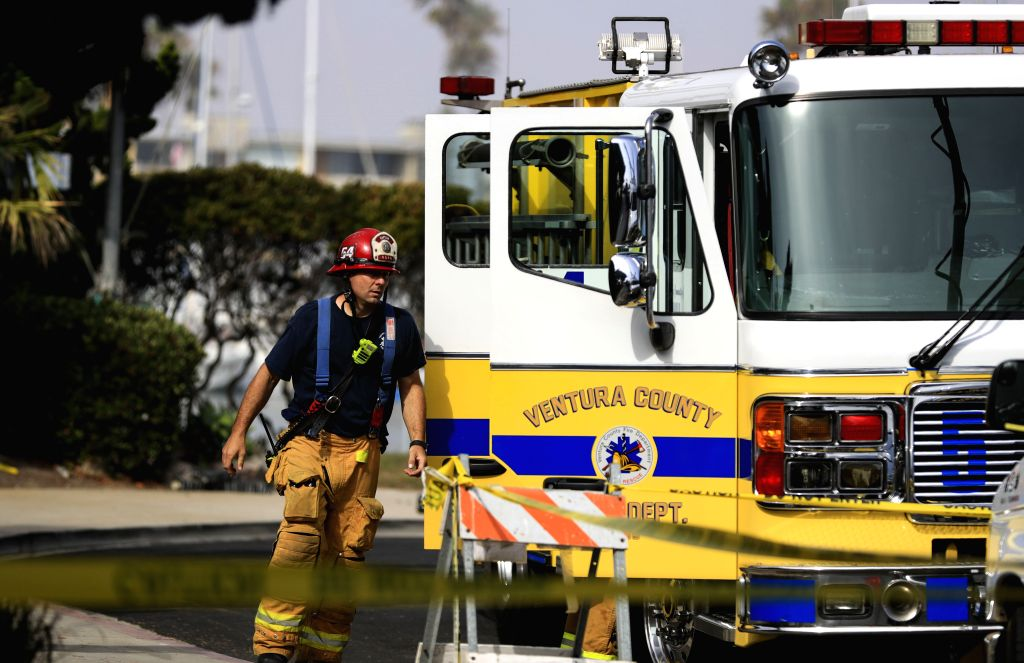 OXNARD (U.S.), Sept. 2, 2019 A firefighter works at the U.S. Coast Guard Station Channel Islands in Oxnard, California, the United States, on Sept. 2, 2019. A total of 34 people are ...