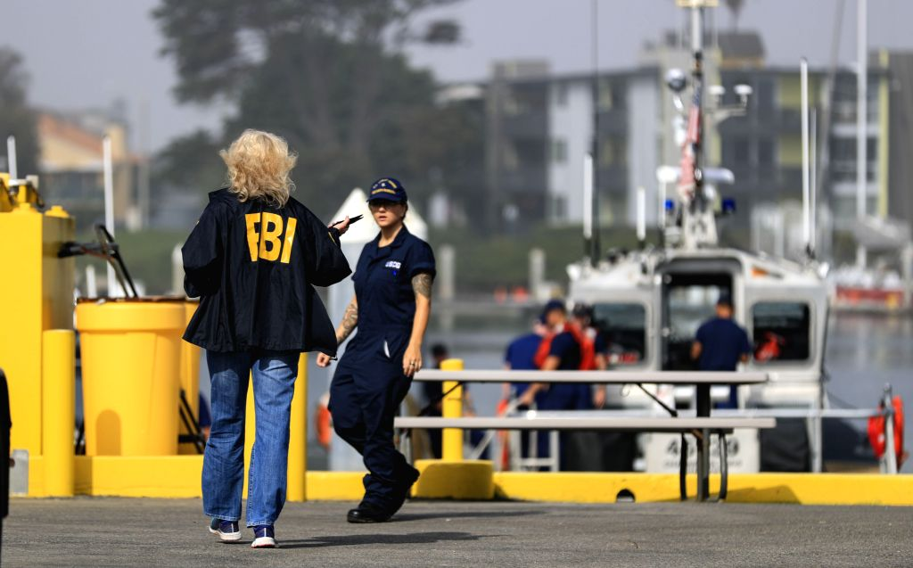OXNARD (U.S.), Sept. 2, 2019 FBI and Coast Guard personnel work at the U.S. Coast Guard Station Channel Islands in Oxnard, California, the United States, on Sept. 2, 2019. A total of 34 ...