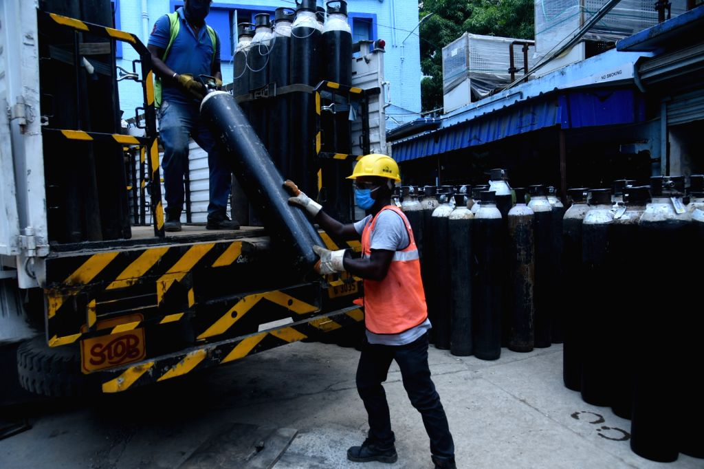 Oxygen cylinders are stored at Kolkata Medical College Hospital during the increasing numbers of Hospital patients in Kolkata  on Saturday, 15 May, 2021.