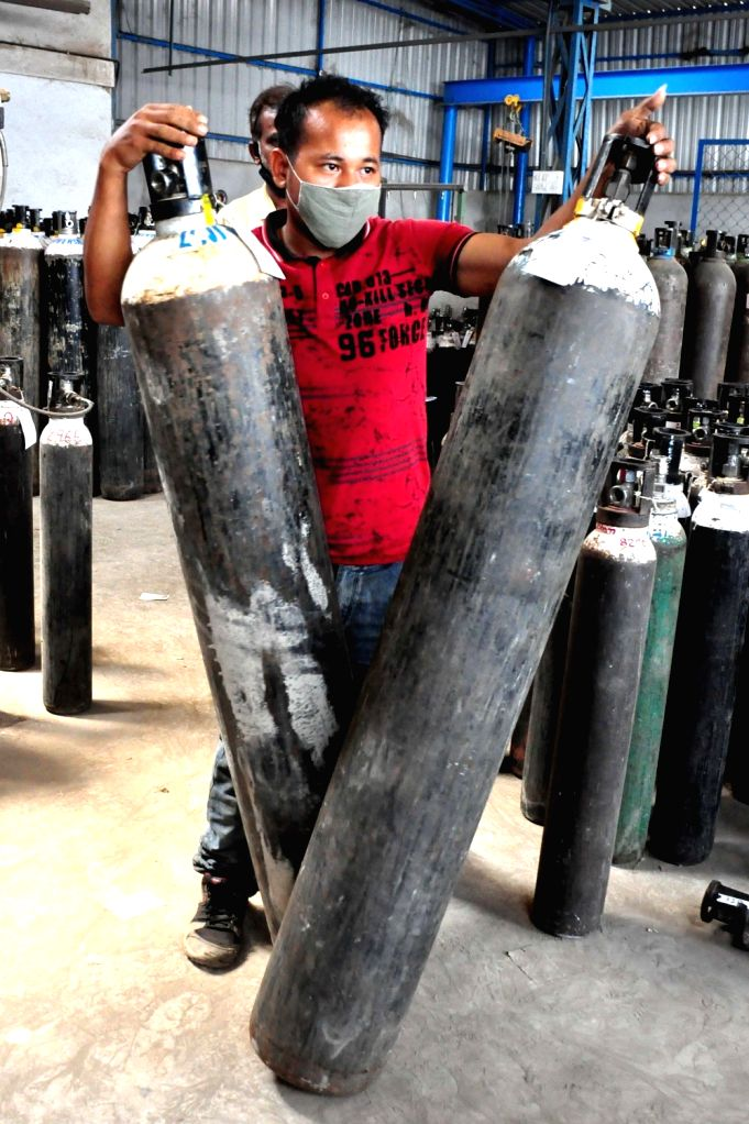 Oxygen cylinders at Universal oxygen unit Peenya due to surge in covid-19 during Coronavirus pandemic , in Bengaluru on Tuesday 20th April 2021.