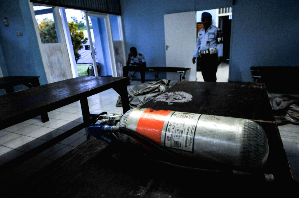 A oxygen tube that suspect as the belongings of Air Asia QZ 8501 is found on the sea of Karimata at Pangkalan Bun airport, Central Kalimantan province, Dec. .