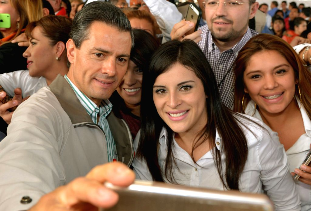 Pachuca City (Mexico): Image provided by Mexico's Presidency shows Mexican President Enrique Pena Nieto (L) attending the opening ceremony of the Center of Justice for Women of Hidalgo State, in the .