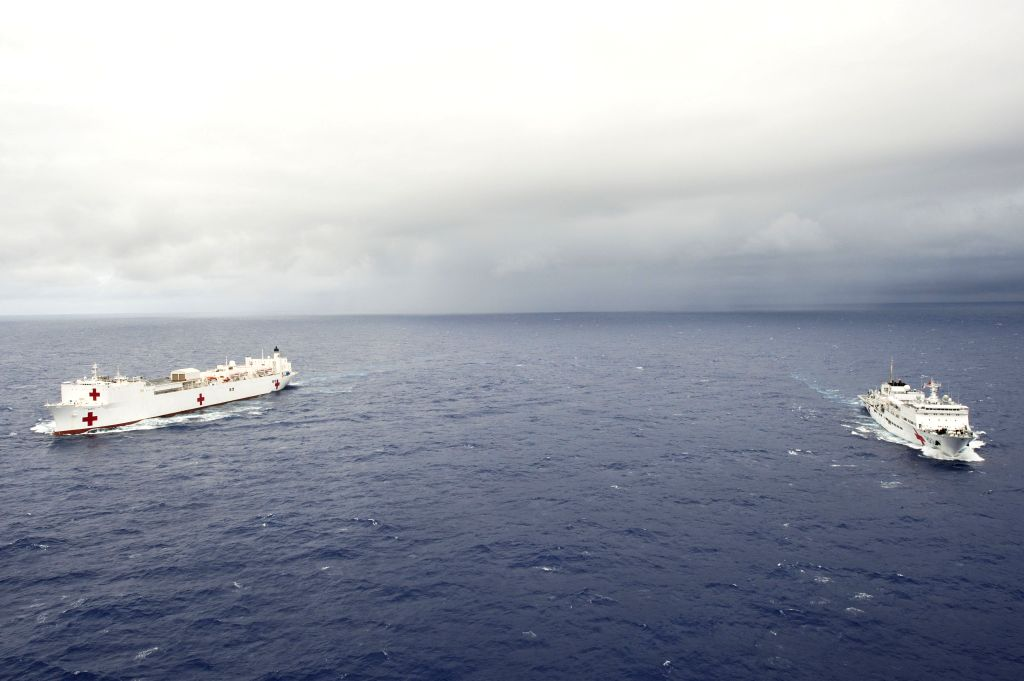 China's hospital ship Peace Ark (R) and USNS Mercy hospital ship are seen during the Rim of the Pacific (RIMPAC) multinational naval exercises on June 22, ...