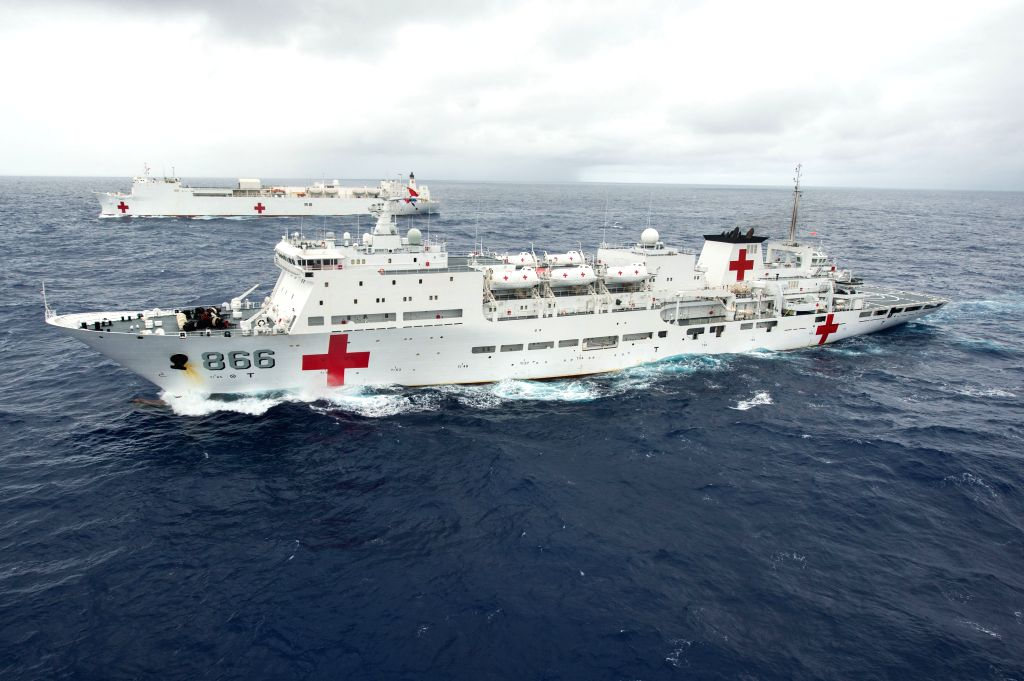 China's hospital ship Peace Ark (Front) and USNS Mercy hospital ship are seen during the Rim of the Pacific (RIMPAC) multinational naval exercises on June 22,