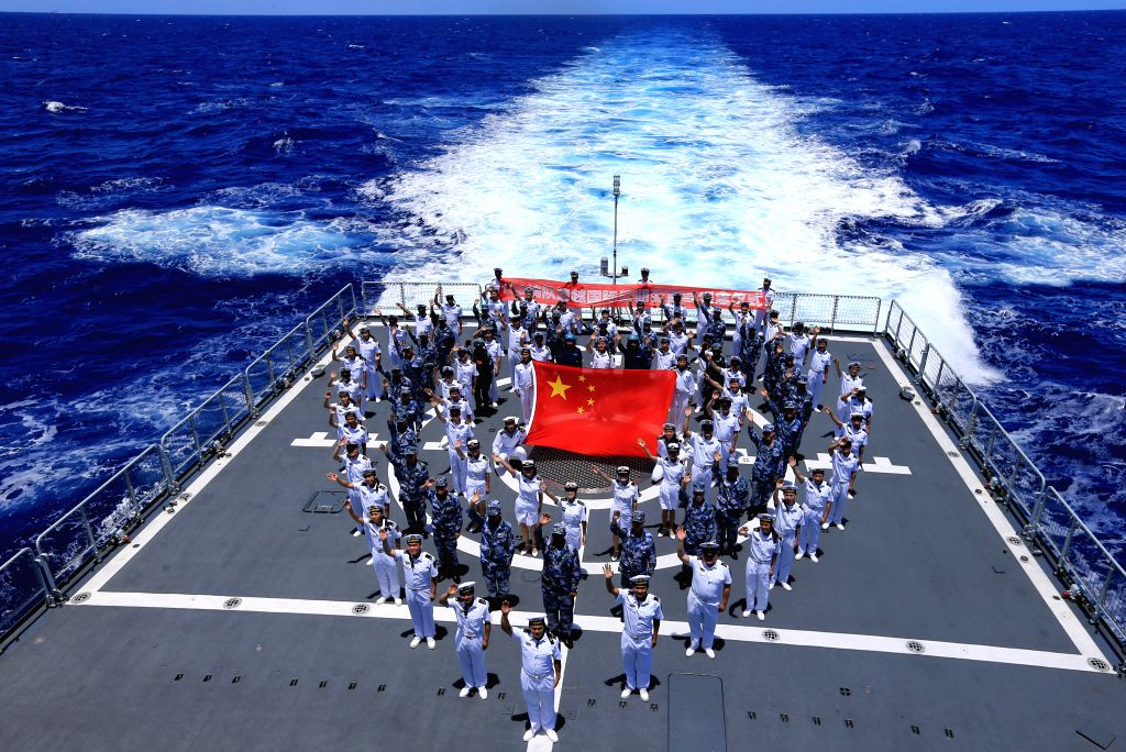 PACIFIC OCEAN, June 25, 2016 - Chinese navy officers stand in formation to mark the moment while crossing the international date line on the Chinese missile destroyer Xi'an during the Rim of the ...