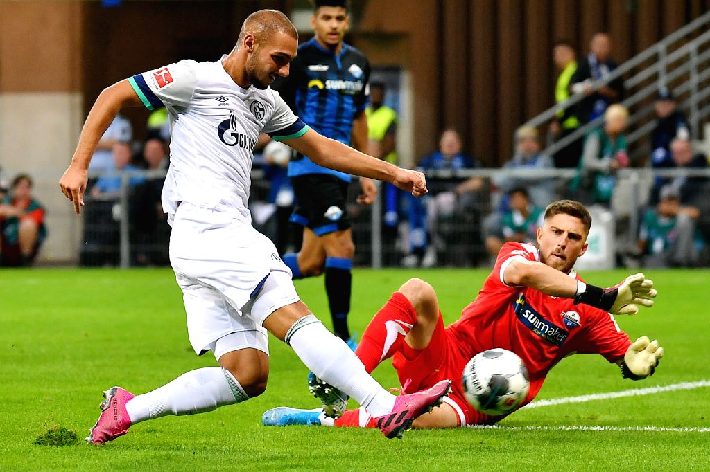 PADERBORN, Sept. 16, 2019 - Ahmed Kutucu (L) of Schalke 04 shoots and scores during the Bundesliga soccer match between SC Paderborn 07 and FC Schalke 04 in Paderborn, Germany, Sept. 15, 2019.