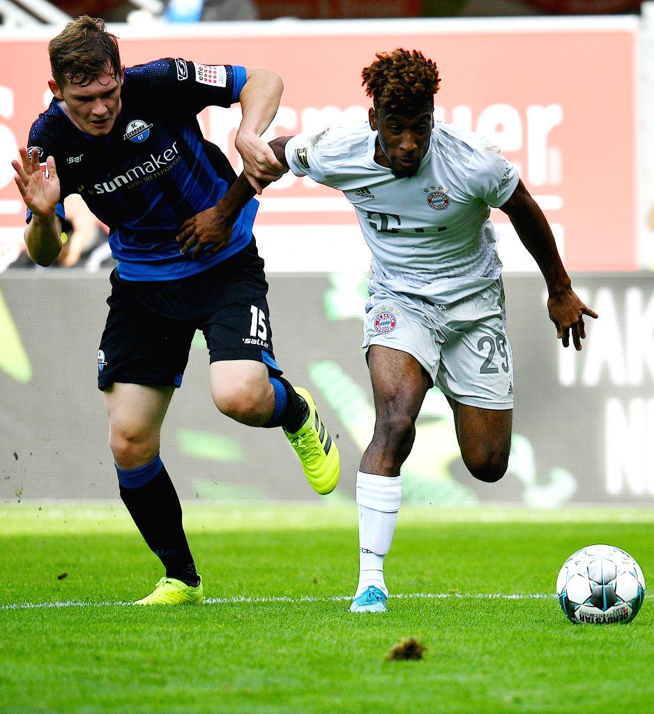 PADERBORN, Sept. 29, 2019 - Kingsley Coman (R) of Bayern Munich vies with Luca Kilian of Paderborn during a German Bundesliga soccer match between SC Paderborn 07 and FC Bayern Munich in Paderborn, ...
