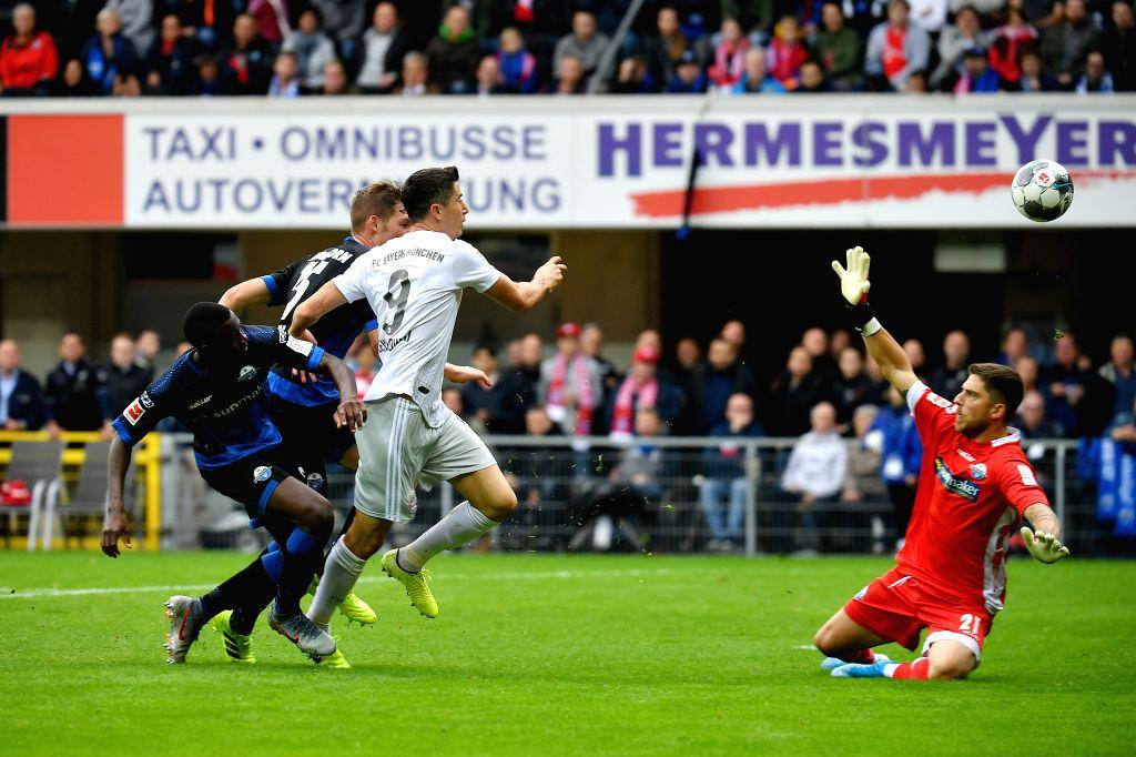 PADERBORN, Sept. 29, 2019 - Robert Lewandowski (3rd L) of Bayern Munich scores during a German Bundesliga soccer match between SC Paderborn 07 and FC Bayern Munich in Paderborn, Germany, Sept. 28, ...