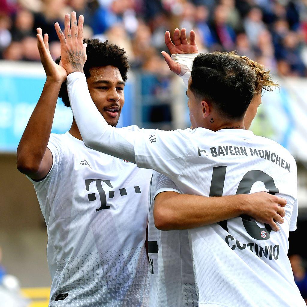PADERBORN, Sept. 29, 2019 - Serge Gnabry (1st, L) of Bayern Munich celebrates after scoring during a German Bundesliga soccer match between SC Paderborn 07 and FC Bayern Munich in Paderborn, Germany, ...