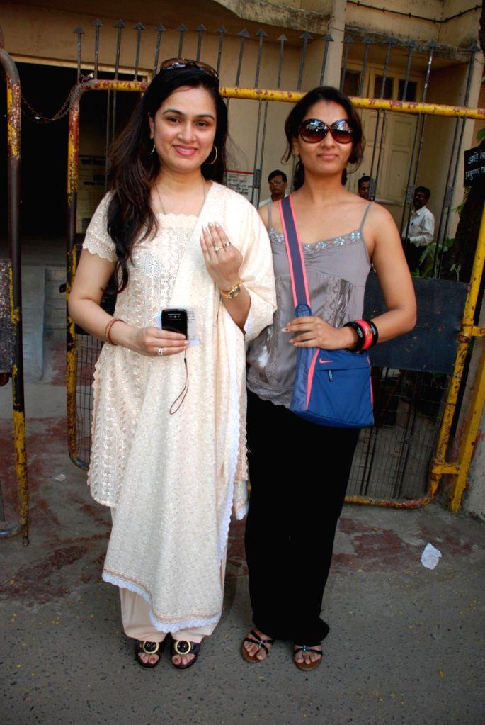 Padmini Kolhapure and her sister Tejaswini Kolhapure after casting their vote in Mumbai.