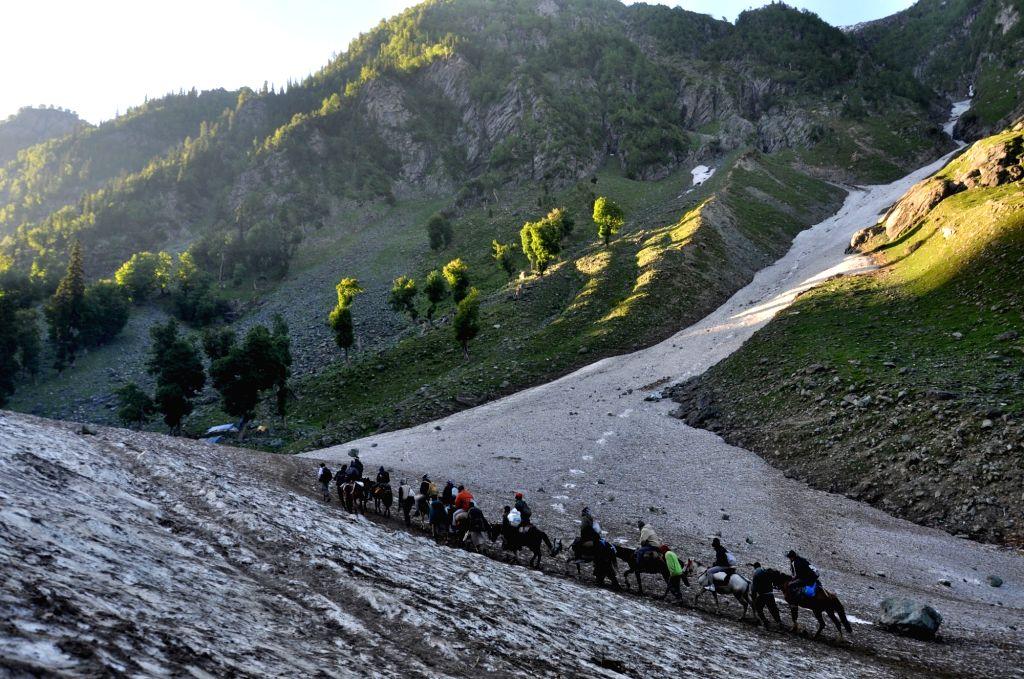 Pahalgam: Pilgrims leave Nunwani base camp in Jammu and Kashmir's Pahalgam to perform the annual Amarnath Yatra that began amid heightened security, on July 1, 2019. (Photo: IANS)