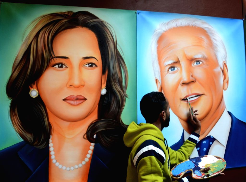 Painter Jagjot Singh Rubal gives the final touches to a painting depicting US President-elect Joe Biden (R) and Vice President-elect Kamala Harris (L) in Amritsar on January 19, 2021. - Jagjot Singh Rubal