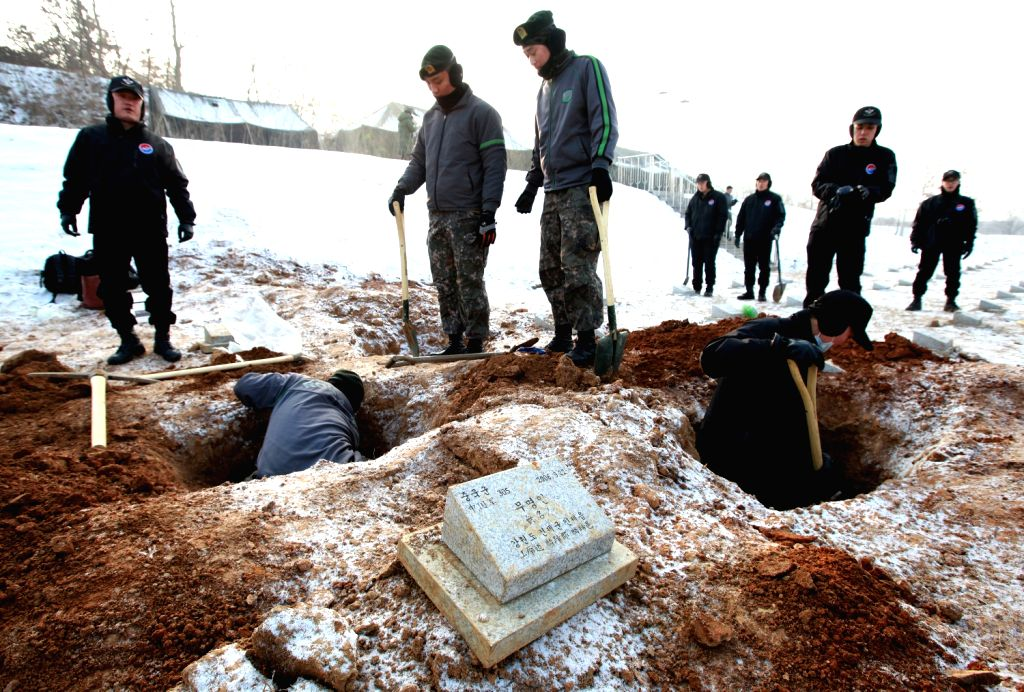 South Korean soldiers excavate the remains of Chinese soldiers buried at a cemetery in Paju, Gyeonggi Province of South Korea, Dec. 20, 2013. South Korea will ...