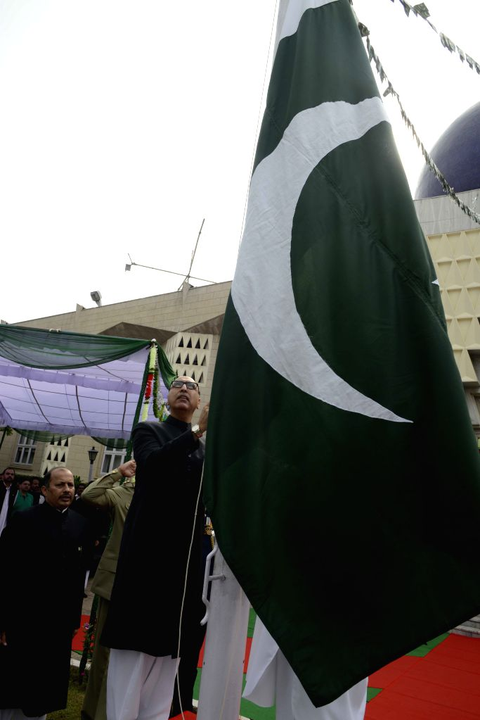Pakistan's High Commissioner to India Abdul Basit hoists the Pakistani flag during Pakistan's Independence day celebration at Pakistan High Commission in New Delhi on Aug 14, 2015.