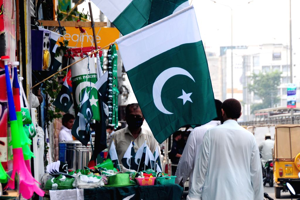 Pakistan's national flags and festive decorations are seen in a market on the eve of the Independence Day in Peshawar, Pakistan, on Aug. 13, 2020.