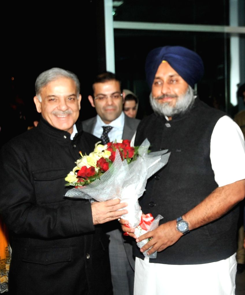 Pakistan`s Punjab Chief Minister Shahbaz Sharif being greeted by Punjab Deputy Chief Minister Sukhbir Singh Badal in Chandigarh on Dec.13, 2013. - Sukhbir Singh Badal