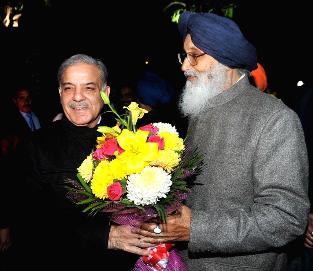 Pakistan`s Punjab Chief Minister Shahbaz Sharif being greeted by Punjab Chief Minister Parkash Singh Badal in Chandigarh on Dec.13, 2013. - Parkash Singh Badal