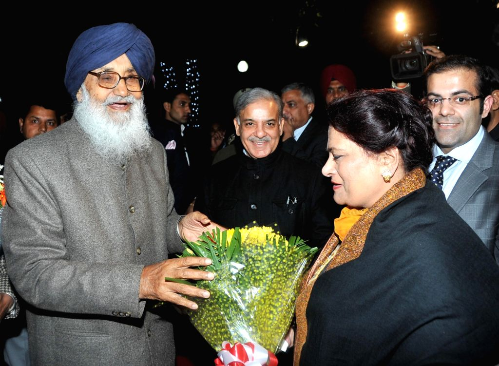 Pakistan`s Punjab Chief Minister Shahbaz Sharif with his wife Nusrat Sharif being greeted by Punjab Chief Minister Parkash Singh Badal in Chandigarh on Dec.13, 2013. - Parkash Singh Badal