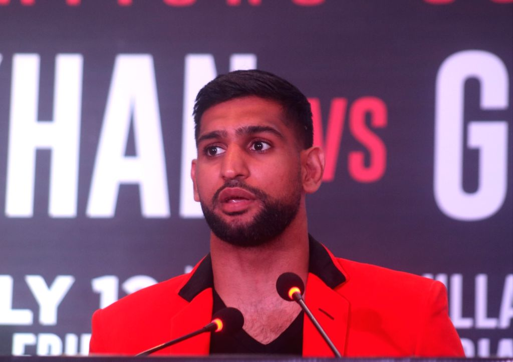 Pakistani boxer Amir Khan addresses a press conference ahead of a face off against Indian boxer Neeraj Goyat at the World Boxing Championship that will take place on July 12, 2019 at the ... - Khan