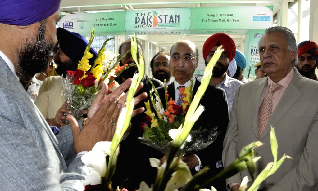 Pakistani High Commissioner to India  Abdul Basit and President of Lahore Chamber of Commerce and Industry  (LCCI) Sohail Lashari during a programme at  Trilium Mall  in Amritsar on  May 8, 2014.