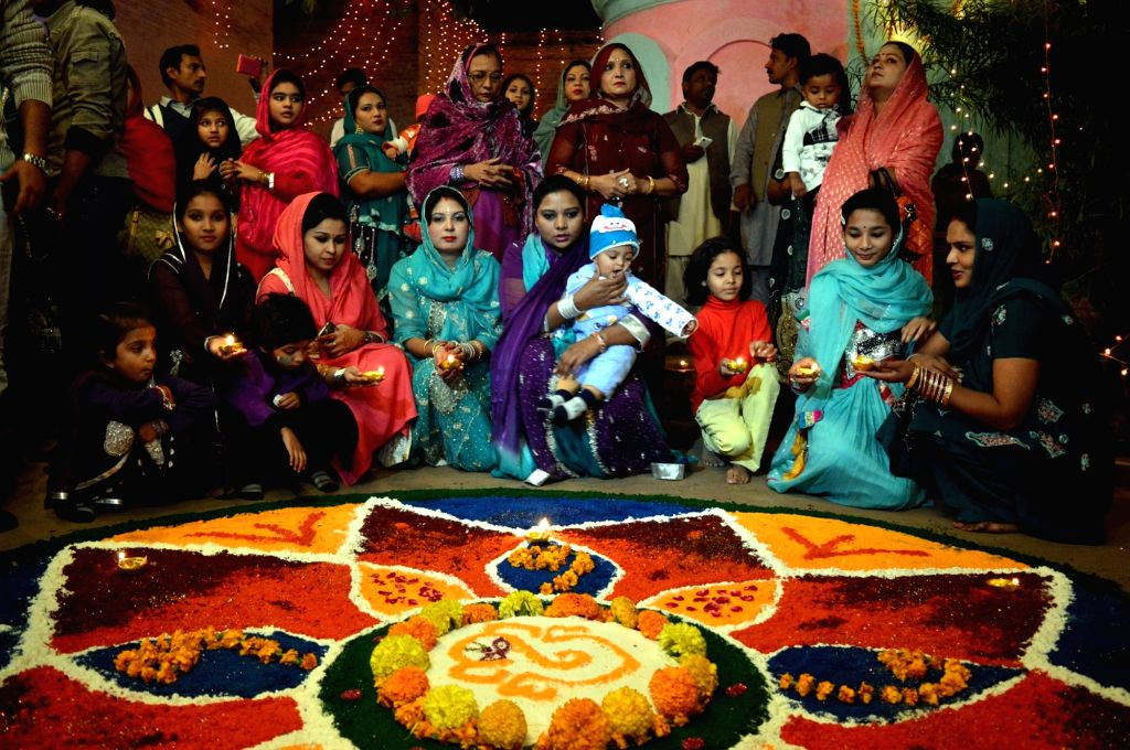 Pakistani Hindu devotees pray during a celebration of Diwali in northwest Pakistan's Peshawar, Nov. 14, 2015. Diwali marks the homecoming of the God Lord Ram after ...