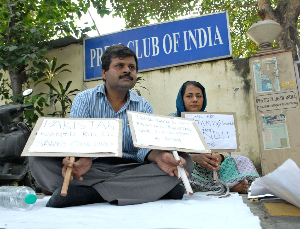 Pakistani journalists Zulfikar Shah and Fatema Shah stage a sit-in protest in front of Press Club of India after receiving continuous life threats in their country, in New Delhi on Oct.22, 2013. Both - Zulfikar Shah and Fatema Shah