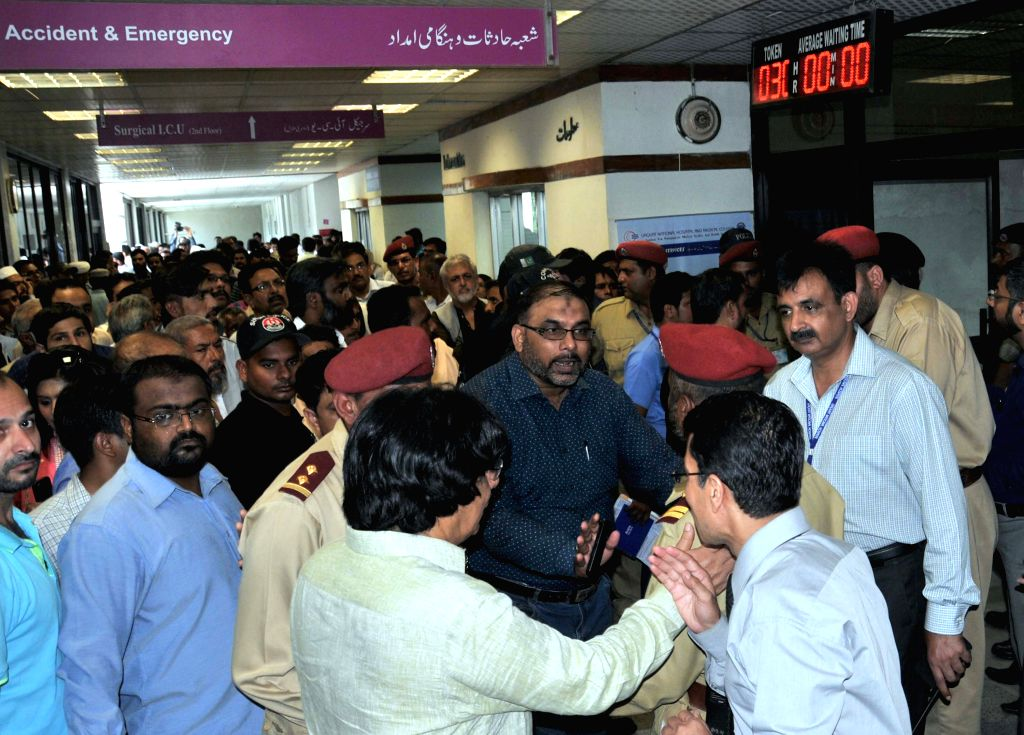 Pakistani Muttahida Qaumi Movement (MQM) workers gather inside a hospital in southern Pakistani port city of Karachi, Aug. 18, 2015. Muttahida Qaumi Movement (MQM) ...