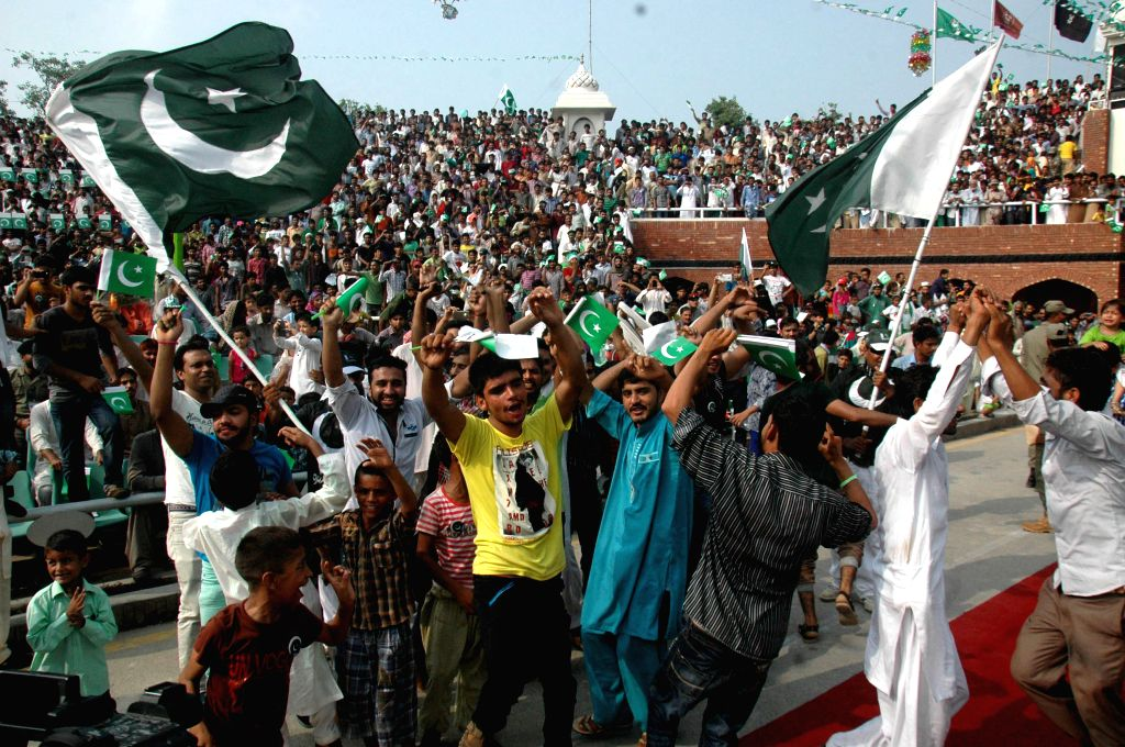 Pakistani people celebrate the country's 68th Independence Day in Lahore, east Pakistan, Aug. 14, 2015. The independence is observed every Aug. 14, when Pakistan got ...