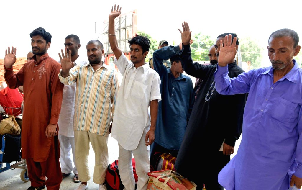 Pakistani prisoners going back home after India released them following completions of their jail term, at Attari international border about 30 kms from Amritsar on July 25, 2017.