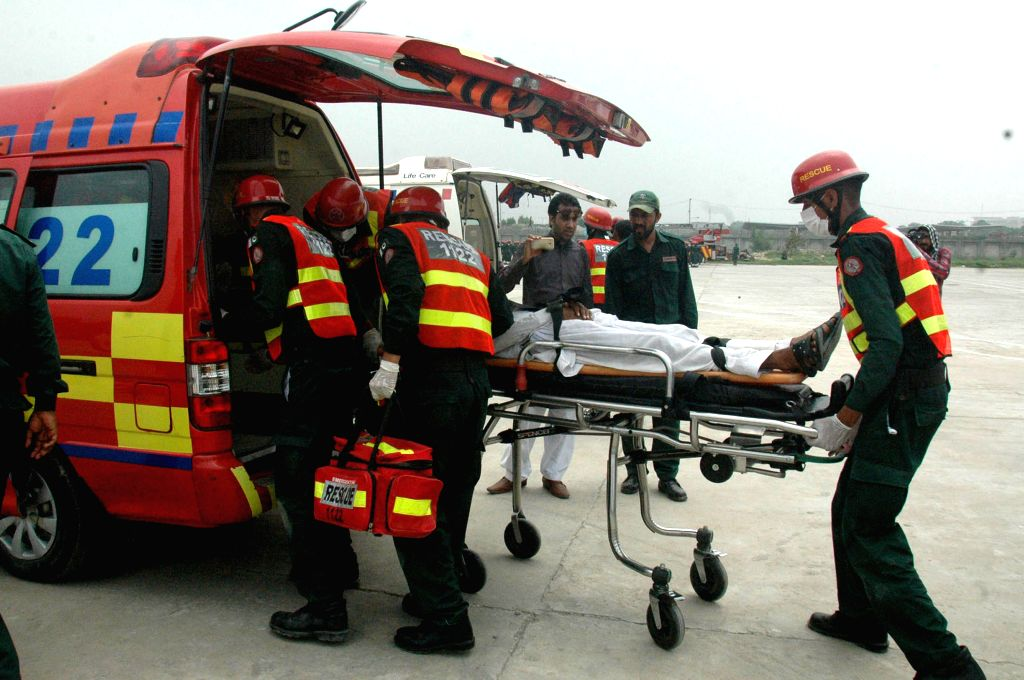 Pakistani rescuers display their skills during passing out parade in eastern Pakistan's Lahore, Aug. 8, 2015. Over 590 more personnel of Rescue 1122 service joined ...