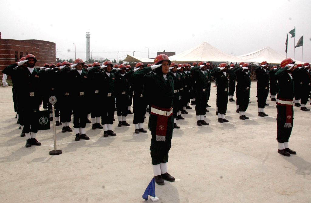 Pakistani rescuers take part in a passing out parade in eastern Pakistan's Lahore, Aug. 8, 2015. Over 590 more personnel of Rescue 1122 service joined the department ...