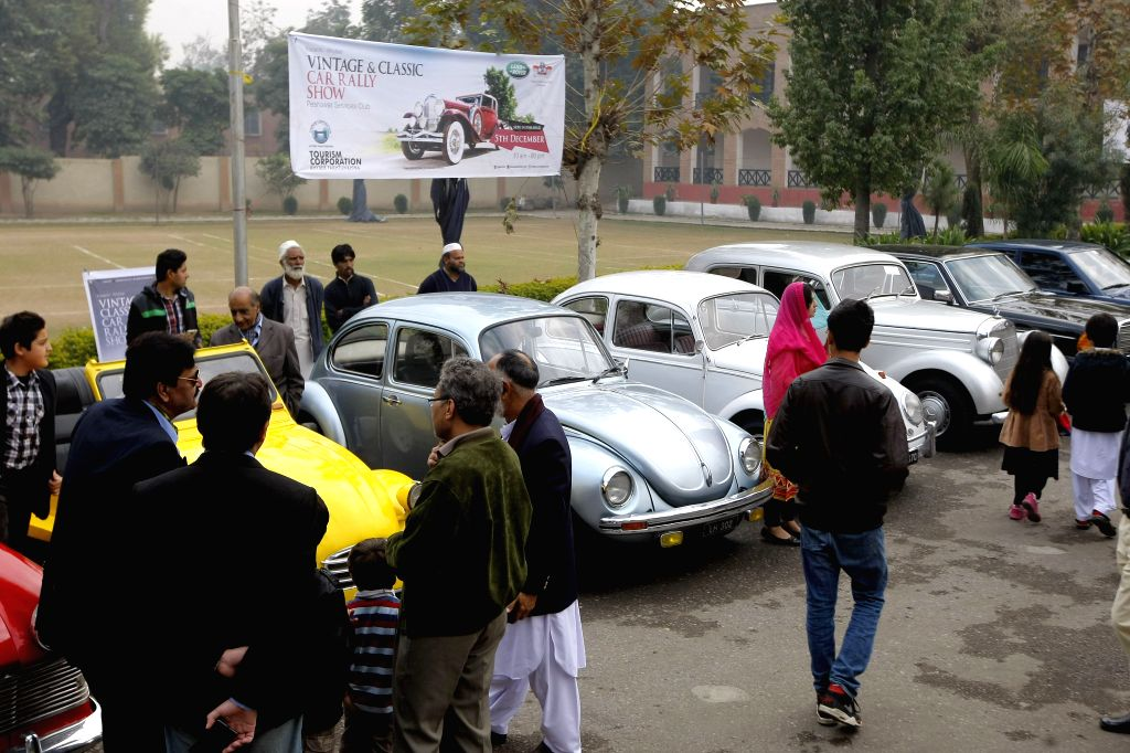 Pakistani visitors look at vintage cars at the Vintage and Classic Car Show in northwest Pakistan's Peshawar on Dec. 5, 2015. The Annual Classic Car Show 2015 was ...