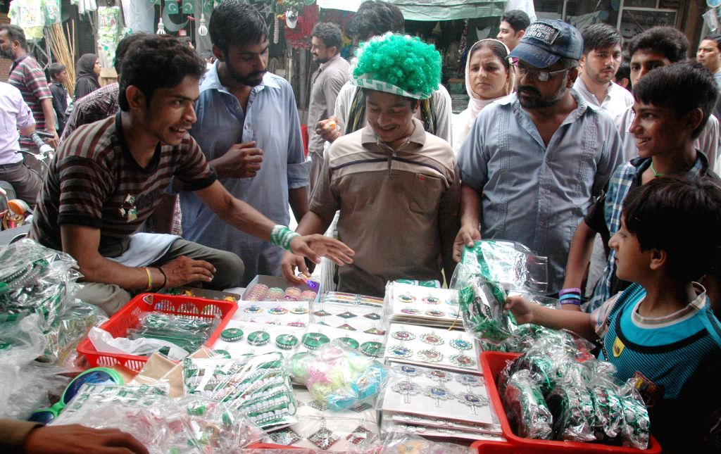 Pakistanis buy badges ahead of the country's Independence Day in Lahore, eastern Pakistan, Aug. 12, 2015. Pakistan will celebrate its Independence Day on Aug. 14. ...