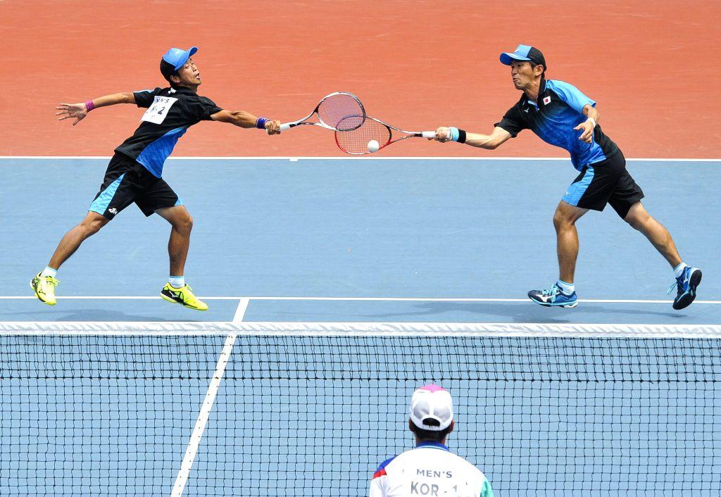 PALEMBANG, Sept. 1, 2018 - Marunaka Taimei and Nagae Koichi of Japan compete against Kim Donghoon and Kim Beomjun of South Korea during soft tennis men's team final between South Korea and Japan at ...