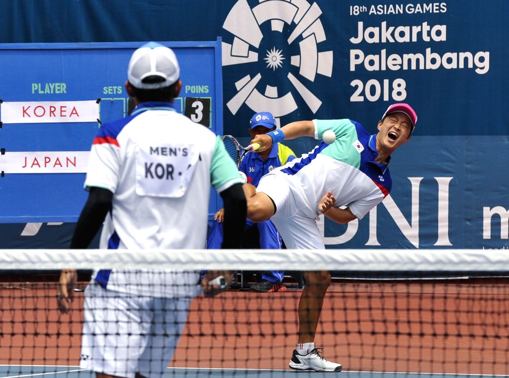 PALEMBANG, Sept. 1, 2018 - Players of South Korea react after winning the soft tennis men's team final between South Korea and Japan at the 18th Asian Games 2018 in Palembang, Indonesia on Sept. 1, ...
