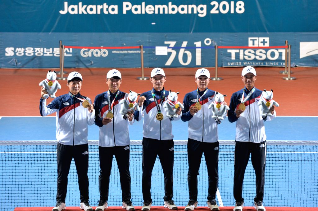 PALEMBANG, Sept. 1, 2018 - Team South Korea, gold medalist, attend the awarding ceremony for the soft tennis men's team event at the 18th Asian Games in Palembang, Indonesia on Sept. 1, 2018.