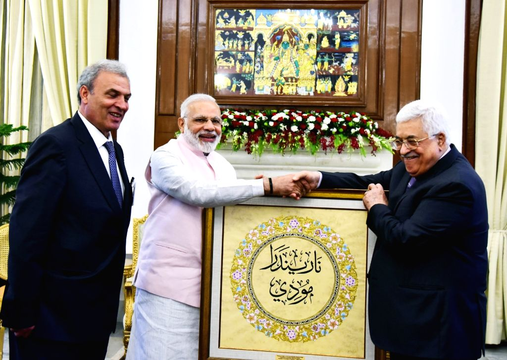 Palestine President Mahmoud Abbas presents the Prime Minister Narendra Modi an artwork having Prime Minister Narendra Modi's name written in Arabic at Hyderabad House, in New Delhi on May ... - Narendra Modi