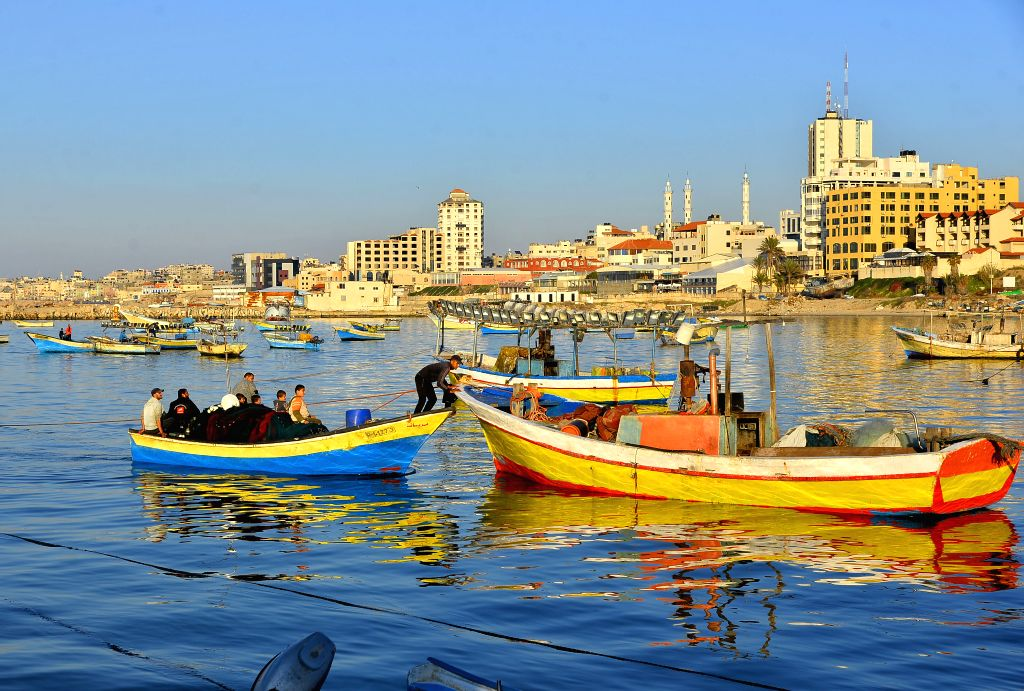 Palestinian fishermen go fishing on their boat at a seaport in Gaza, Feb. 5, 2020. The Israeli army decided on Wednesday to reduce the allowed fishing zone off the Gaza ...