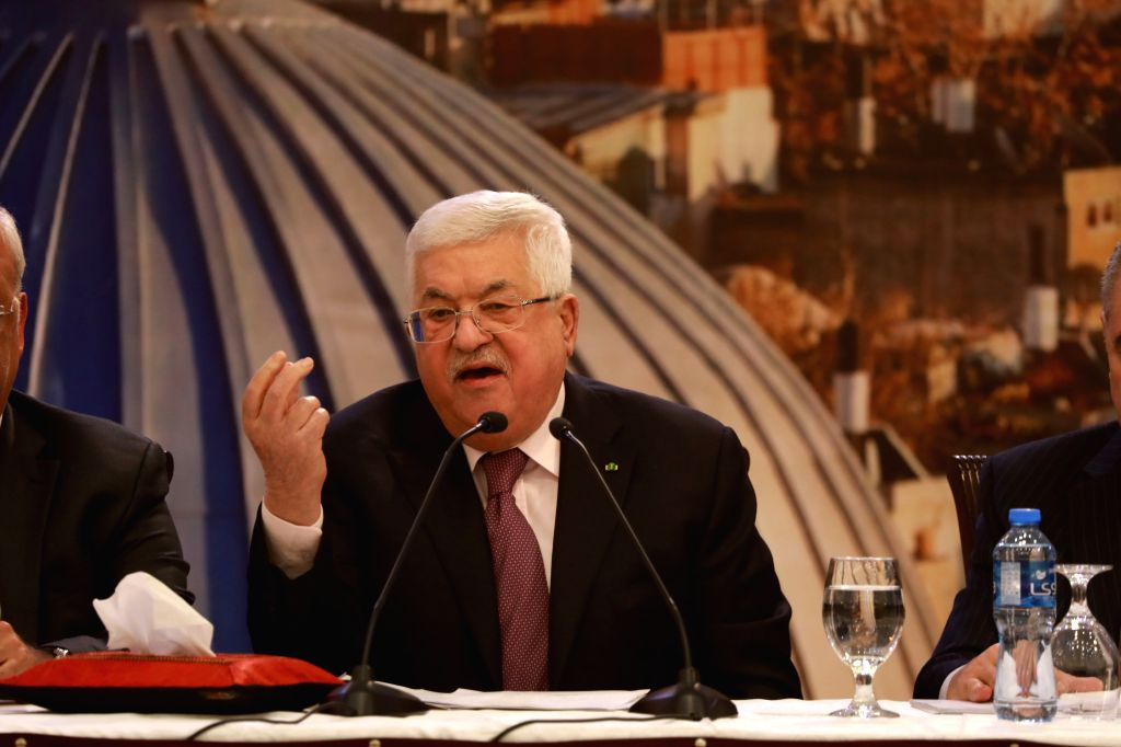 Palestinian President Mahmoud Abbas speaks during a press conference following the Palestinian leadership meeting, in the West Bank city of Ramallah, Jan. 28, ...