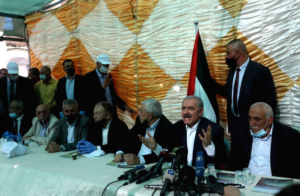 Palestinian Prime Minister Mohammed Ishtaye (2nd R, Front) speaks during a meeting in Fasayil village in the Jordan Valley, on June 24, 2020. The Palestinian ... - Mohammed Ishtaye